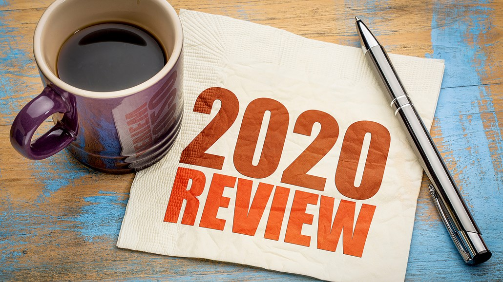 Napkin with 2020 Review written next to a cup filled with coffee