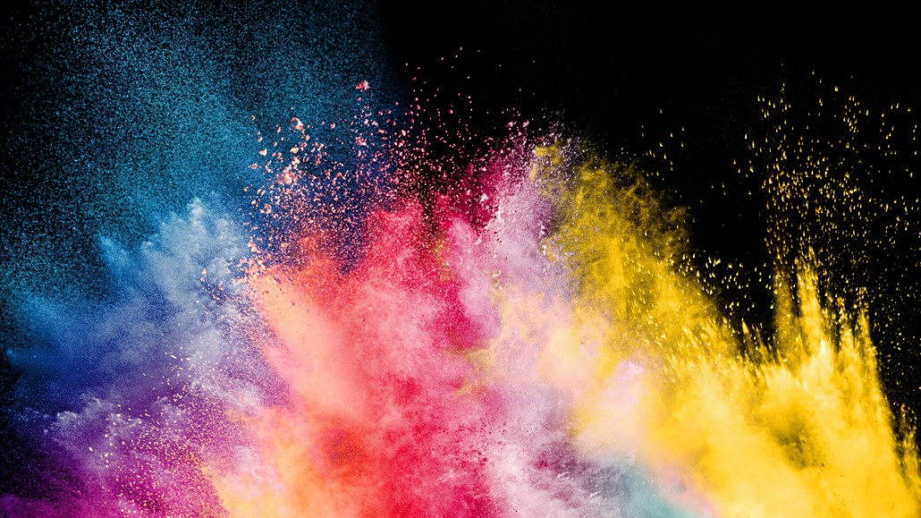 Explosion of rainbow colors on a black background