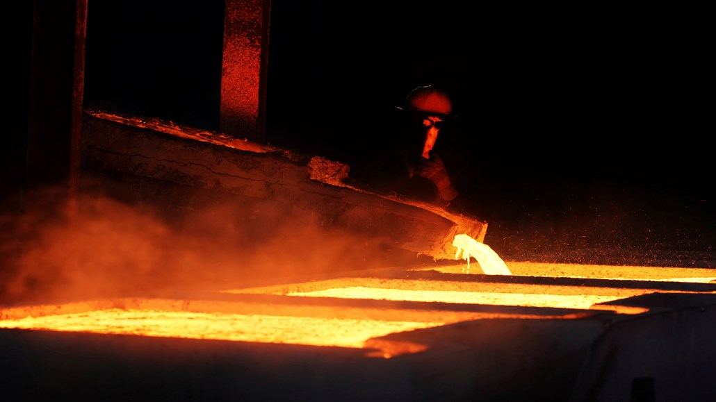 Worker pouring liquid molten metal